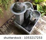 unique stone water fountain and ... | Shutterstock . vector #1053217253