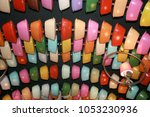 colored cast iron pan under the ... | Shutterstock . vector #1053230936