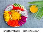 tropical fruits assortment on a ... | Shutterstock . vector #1053232364
