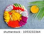 tropical fruits assortment on a ... | Shutterstock . vector #1053232364
