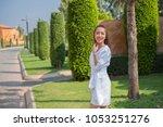 fashion asian girl in outdoor... | Shutterstock . vector #1053251276
