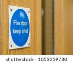 fire door keep shut sign on a... | Shutterstock . vector #1053259730