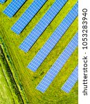 aerial view of solar panels.... | Shutterstock . vector #1053283940