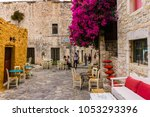areopoli mani  greece  august ... | Shutterstock . vector #1053293396