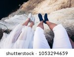 couple in love sits on a high... | Shutterstock . vector #1053294659