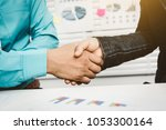 shaking hands  bank lending to... | Shutterstock . vector #1053300164
