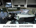 self driving truck with head up ... | Shutterstock . vector #1053308990