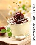 dairy dessert with chocolate sauce and cherries - stock photo