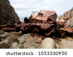 abandoned rusted wreck on the... | Shutterstock . vector #1053330950