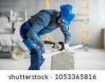 builder in working uniform... | Shutterstock . vector #1053365816