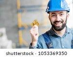 happy builder in working... | Shutterstock . vector #1053369350
