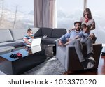 happy couple spending time with ... | Shutterstock . vector #1053370520