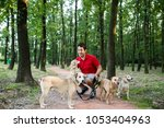 Stock photo dog walker with dogs enjoying in walk 1053404963