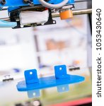 3d printer of the device during ... | Shutterstock . vector #1053430640