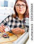 female apprentice working on... | Shutterstock . vector #1053430664