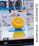 ripe slice of yellow lemon... | Shutterstock . vector #1053430670