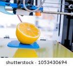 ripe slice of yellow lemon... | Shutterstock . vector #1053430694