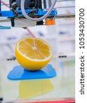 ripe slice of yellow lemon... | Shutterstock . vector #1053430700