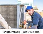 a professional electrician man... | Shutterstock . vector #1053436586