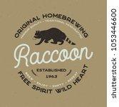 wild animal badge with raccoon... | Shutterstock . vector #1053446600