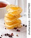 crispy delicious pepper potato... | Shutterstock . vector #1053447980