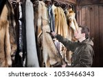 fur animals in the processing... | Shutterstock . vector #1053466343