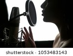 girl singing to the microphone...   Shutterstock . vector #1053483143