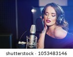 beautiful young singer who... | Shutterstock . vector #1053483146