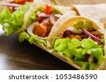 mexican burrito with chicken ... | Shutterstock . vector #1053486590