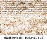 texture of a brick wall.... | Shutterstock . vector #1053487523