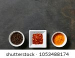 various spices with peppercorn  ... | Shutterstock . vector #1053488174
