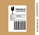 fragile barcode packaging label ... | Shutterstock .eps vector #1053499070