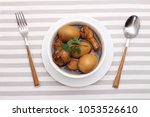 egg and pork in sweet brown... | Shutterstock . vector #1053526610