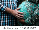 black father loves his pregnant ... | Shutterstock . vector #1053527549