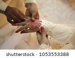 a malay bridegroom  holds his... | Shutterstock . vector #1053553388