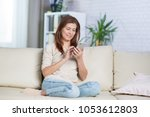 beautiful adult woman at home... | Shutterstock . vector #1053612803