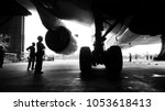 Stock photo aircraft push back into the maintenance area aircraft airplane in aircraft hangar for maintenance 1053618413