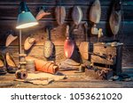 tools  shoes and leather in... | Shutterstock . vector #1053621020