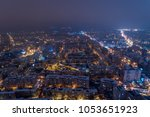 winter night aerial view from... | Shutterstock . vector #1053651923
