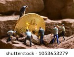 little miner is digging for... | Shutterstock . vector #1053653279