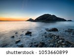stunning sunrise over the... | Shutterstock . vector #1053660899
