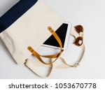 women bag with sunglasses on... | Shutterstock . vector #1053670778