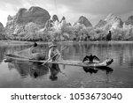 yangshuo   june 18  chinese man ... | Shutterstock . vector #1053673040