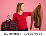 people  shopping and choice... | Shutterstock . vector #1053679898
