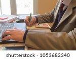 businesspersons analyzing... | Shutterstock . vector #1053682340