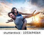 couple of lovers on a romantic... | Shutterstock . vector #1053694064