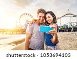 couple of lovers on a romantic... | Shutterstock . vector #1053694103