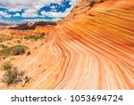Small photo of The Wave is an awesome vivid swirling petrified dune sandstone formation in Coyote Buttes North. It could be seen in Paria Canyon-Vermilion Cliffs Wilderness, Arizona. USA