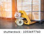 pallet goods with manual... | Shutterstock . vector #1053697760