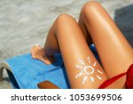 young woman with sun shape on... | Shutterstock . vector #1053699506